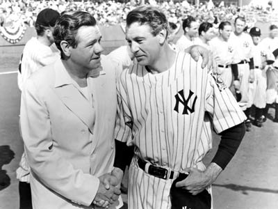 Babe Ruth shakes hands with Gary Cooper, the actor who portrayed Lou Gehrig in