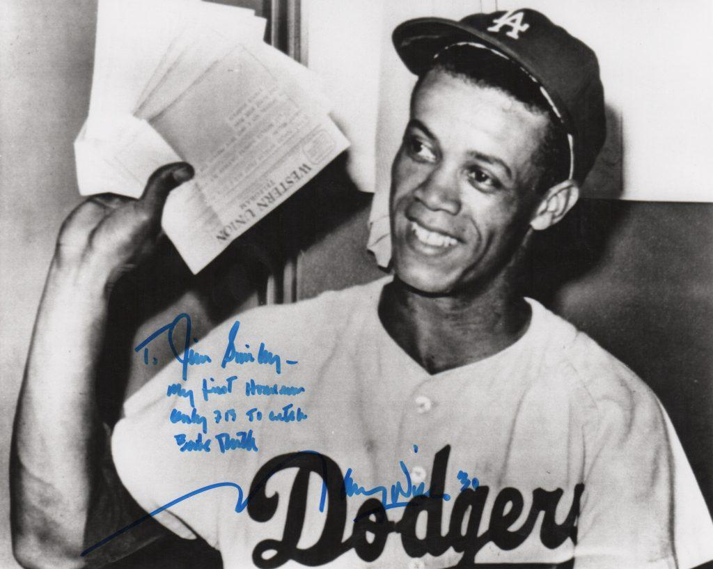Maury Wills receives congratulatory telegrams after hitting his first big league homer