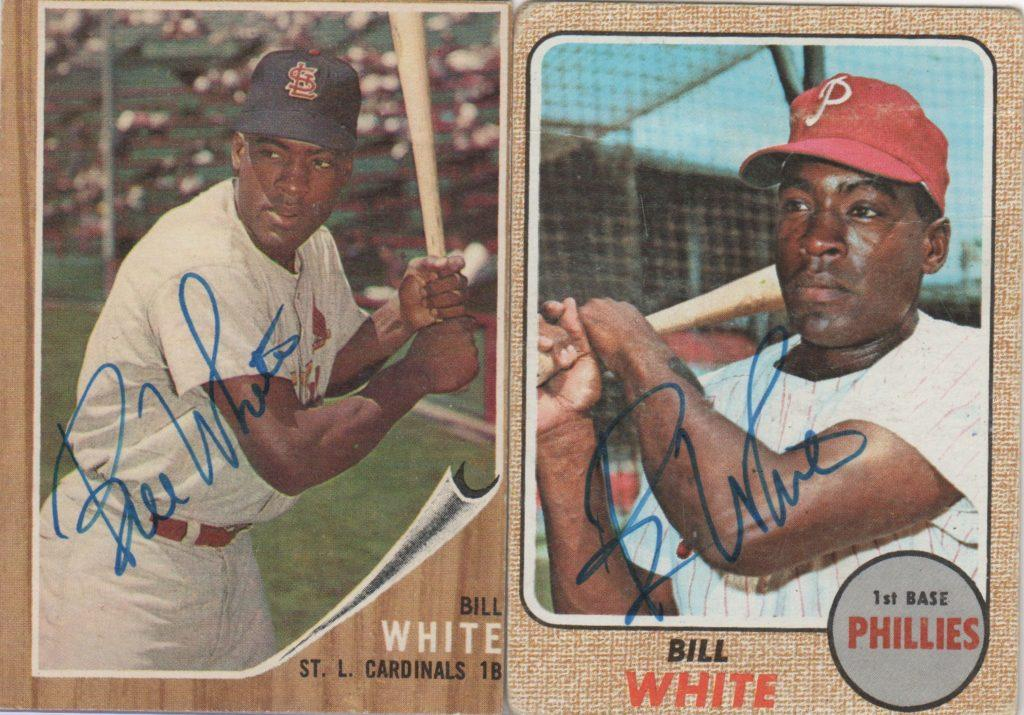 Bill White signs a pair of cards