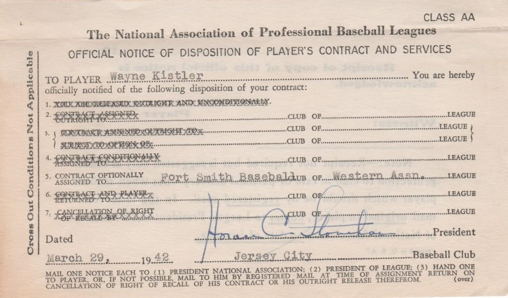 Horace Stoneham signs reassignment document for minor leaguer