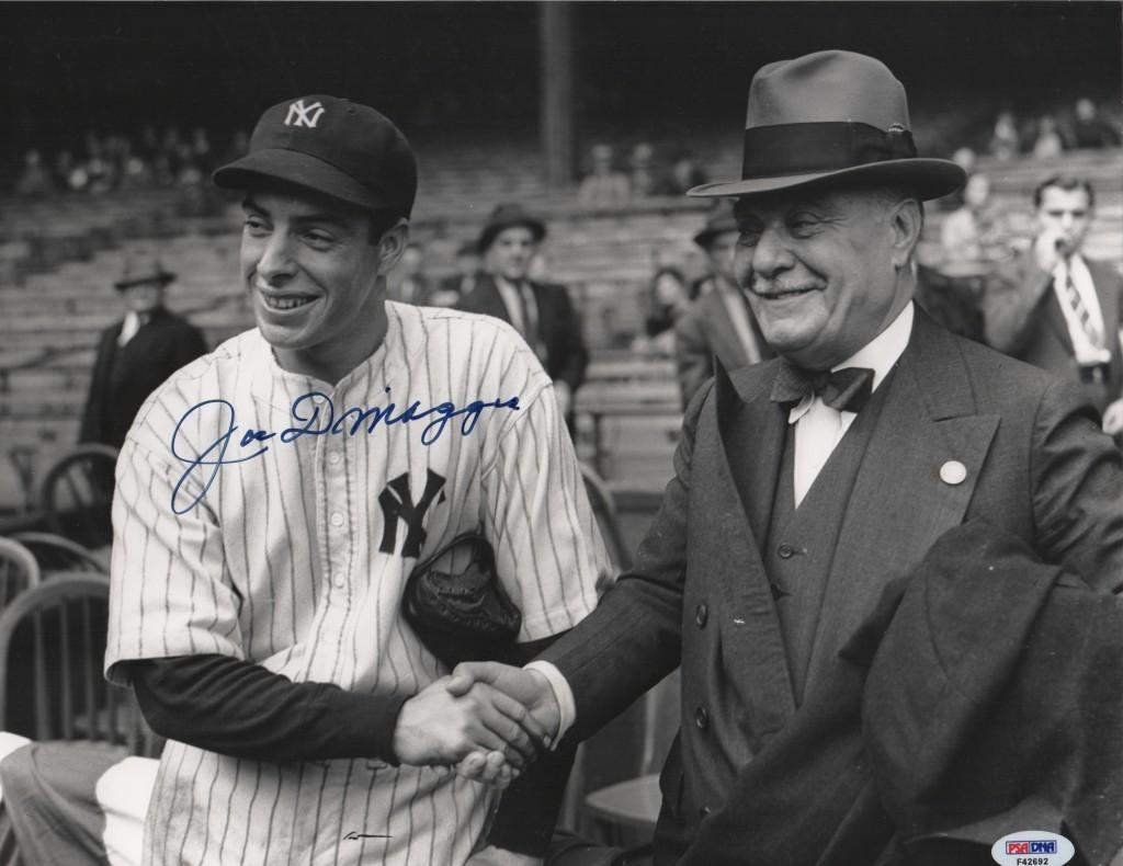 Joe DiMaggio shakes hands with the Yankee owner Jacob Ruppert
