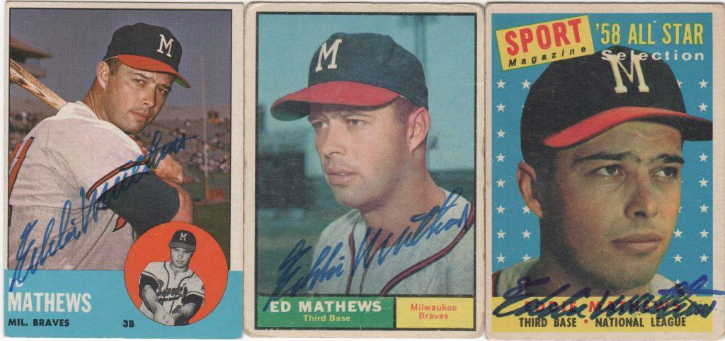 A trio of autographed Eddie Mathews Topps cards