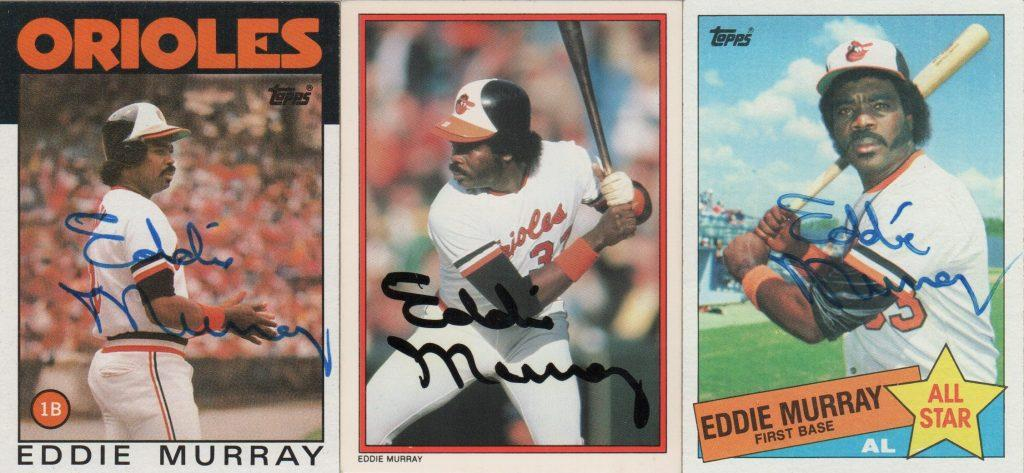 Three Topps baseball cards signed by the Oriole great