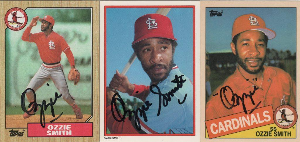 A trio of Topps cards autographed by the Wizard