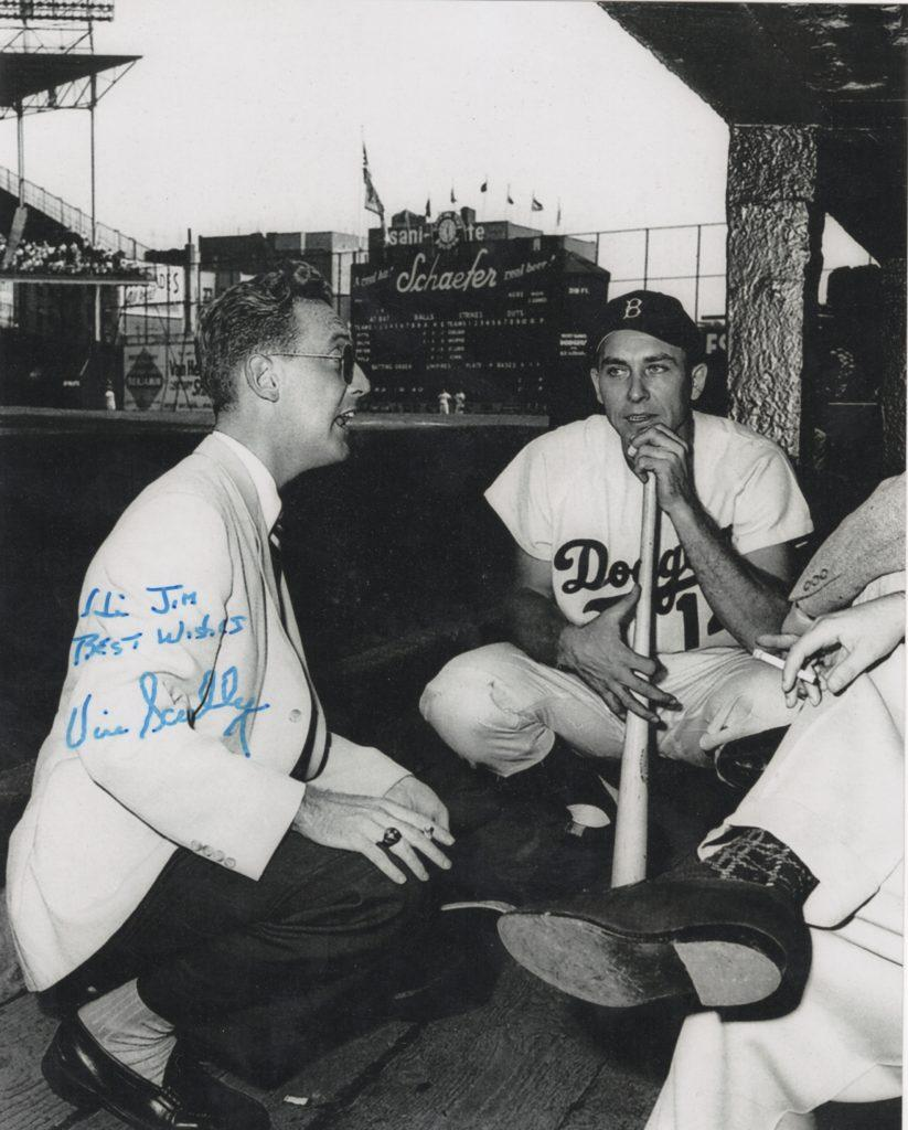 A young Vin Scully holds court with Gil Hodges and other