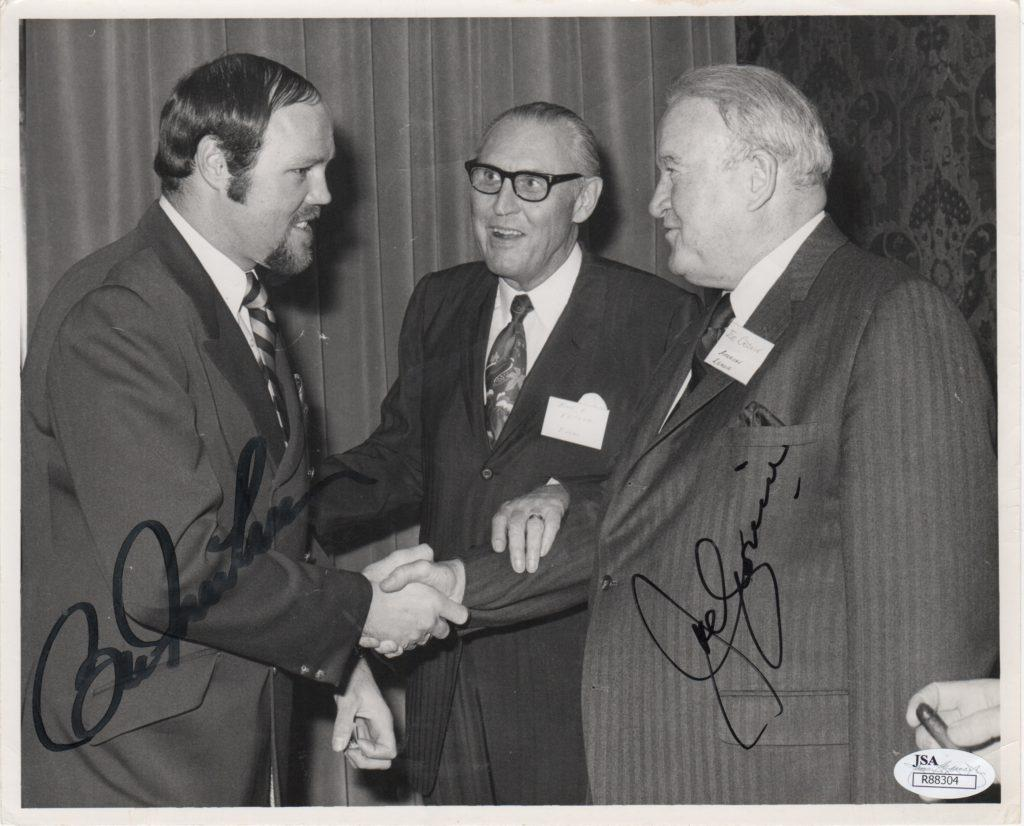 AL chief Joe Cronin shakes hands with 11-time All Star Bill Freehan, both have signed this photo
