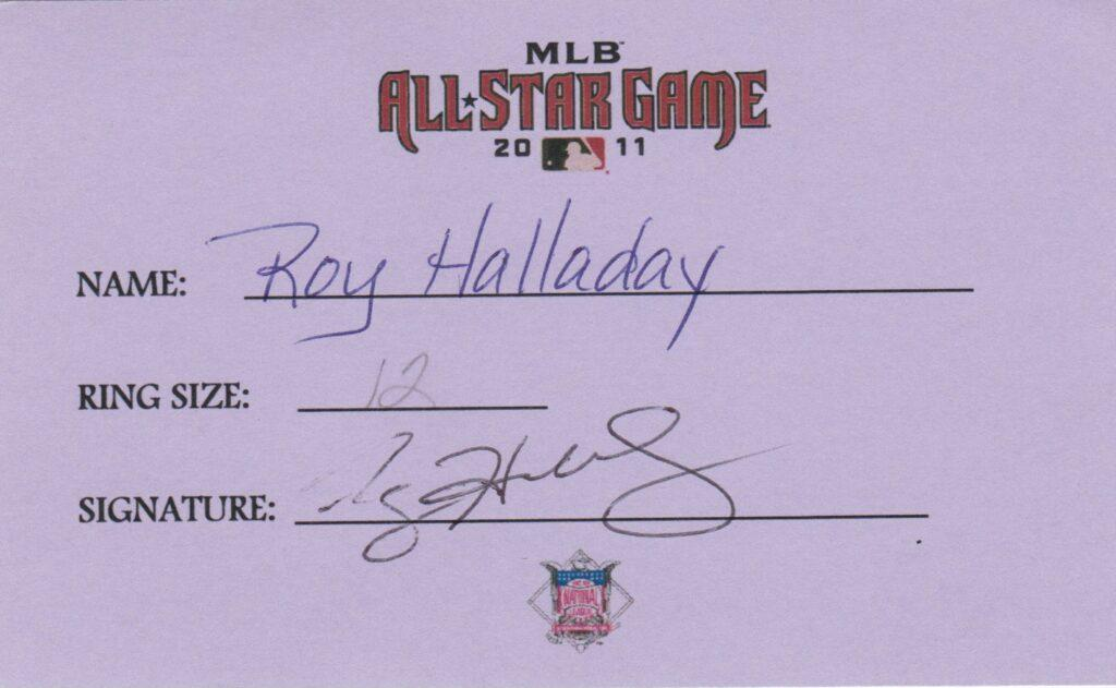Roy Halladay made 8 All Star games; here he signs for his final ASG ring in 2011