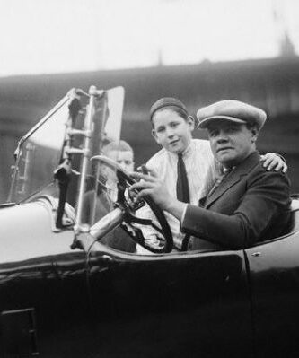 Babe Ruth drives a car